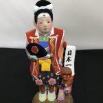 津屋崎人形「さる連れ桃太郎」